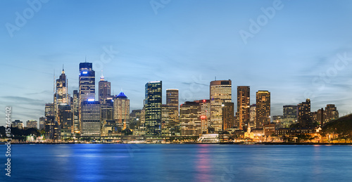 Sydney skyline after sunset with blue sky