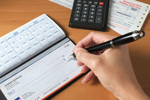 Writing A Check To Pay The Bills