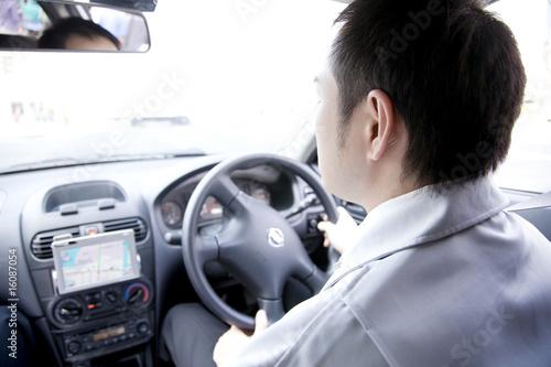 Fotografie, Obraz  車を運転するビジネスマン