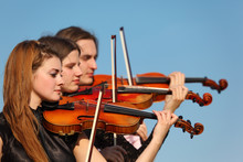 Trio Of Violinists Plays Again...