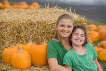 Mother And Daughter In The Pumpkin Patch