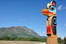 Eagle Totem Pole Against A Blu...