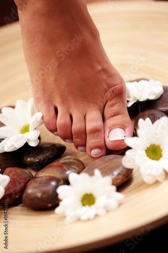 Foto op Plexiglas feet and pebbles