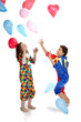 interracial children in clown costums playind together