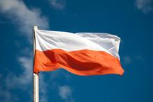 Polish Flag Against Blue Sky