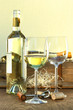 Still life of white wine bottle and glasses with crate