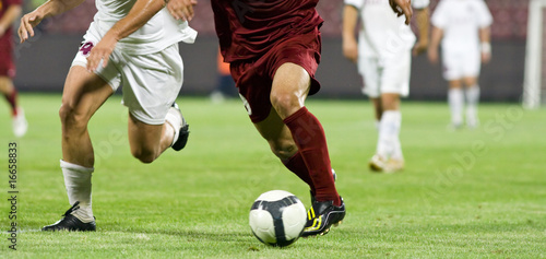 Photo  Soccer players running after the ball