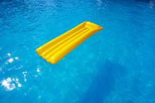 Yellow Mattress In The Pool