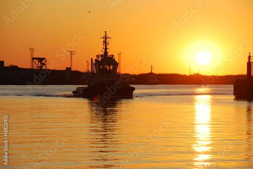 Staande foto Zeilen Ship on river in sunset
