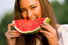 Pretty Woman Eating Watermelon...