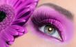 Leinwandbild Motiv Purple eye make-up with gerber flower