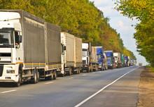 Queue Of Varied Trucks, Landsc...