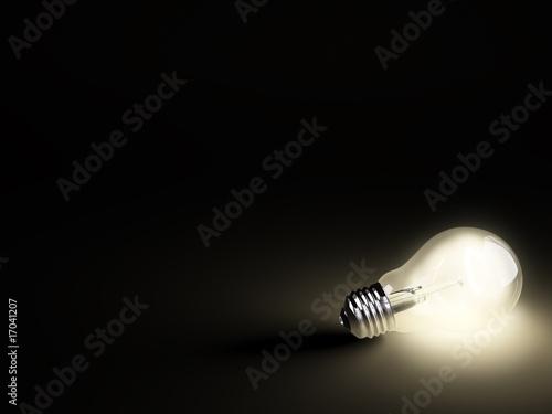 Fototapety, obrazy: Luminous light bulb on black