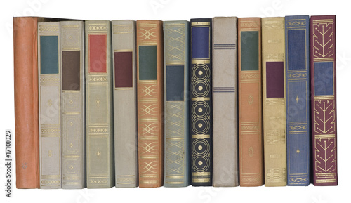 Fotografija  vintage books in a row, isolated, free copy space