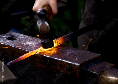 Obraz na plátně Blacksmith hammering hot metal