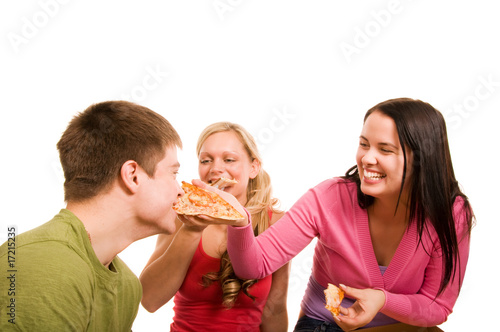 Foto op Canvas Kruidenierswinkel Friends are having fun and eating pizza