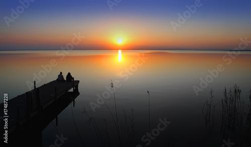 Fotobehang Pier Mirando el sol