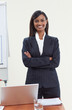 Confident ethnic businesswoman in office