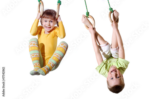 Photo  children on gym sports rings