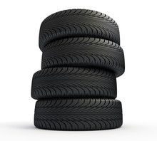 Stack Of New Tires Isolated On White