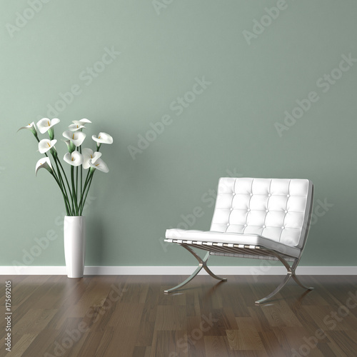 Valokuva  white barcelona chair on green