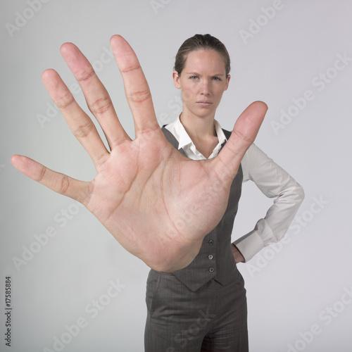 Fotografie, Obraz  jeune femme d'affaires main signal stop