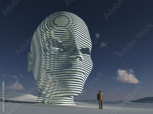 Fotografia lonely man standing before big mystical head
