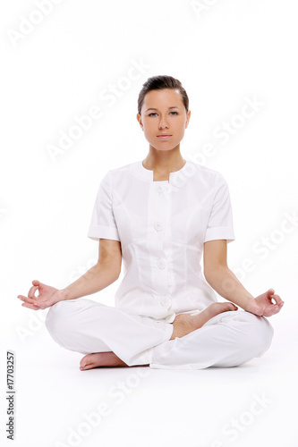 a beautiful young woman in lotus pose