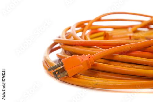 Fototapeta An orange extension cord on white obraz