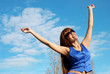 The young woman in sunglasses looking in a sky