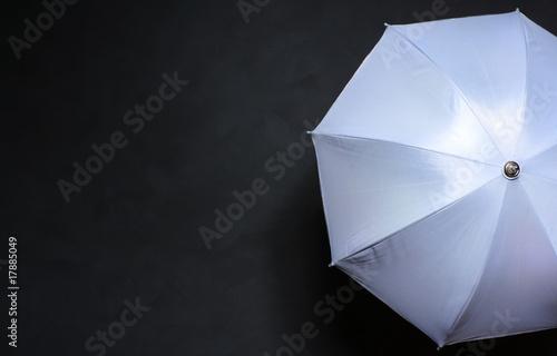 Fototapeta white umbrella on a gray background obraz na płótnie