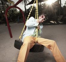 Man On A Tire Swing