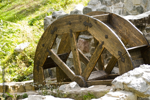 Poster Molens Old watermill with a wooden wheel and stone walls