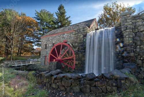Valokuva  old grist mill with water wheel used to power grinding stones