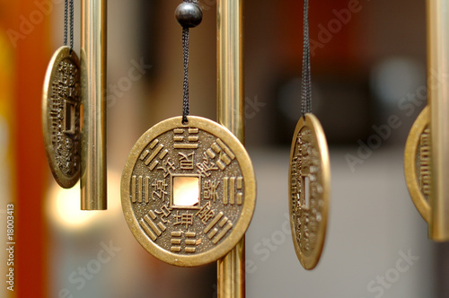 Old chinese bronze bell with hieroglyphs. Canvas Print