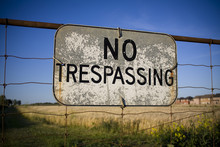 No Trespassing Sign Against Ba...