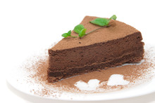 Chocolate Cheesecake Decorated With Mint Sprig