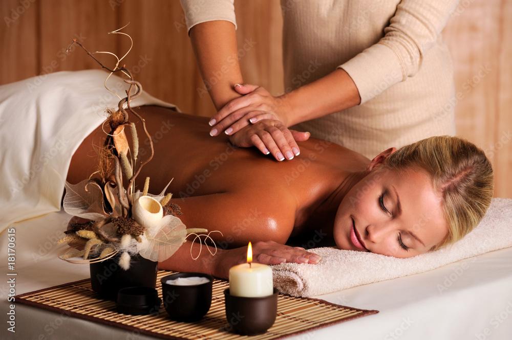 Fototapeta professional masseur doing massage of female back