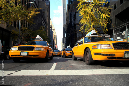 Foto op Plexiglas New York TAXI yellow cabs