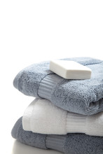 White And Blue Towels With Soa...
