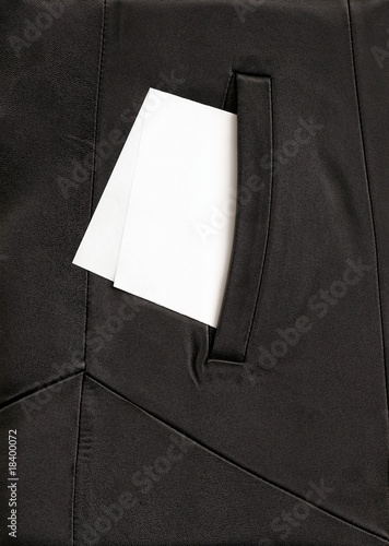 white paper in the pocket of black cloak Wallpaper Mural