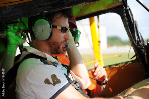 Fotografie, Obraz  Two pilots testing the radio