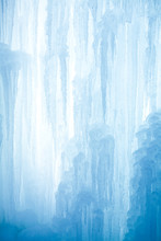 A Frozen Waterfall With Ice In...