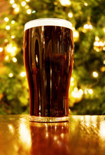 Christmas In Ireland With Pint Of Black Beer In A Pub