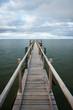 Footbridge under moody sky