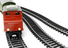 Toy Diesel Locomotive And Caboose On White Background