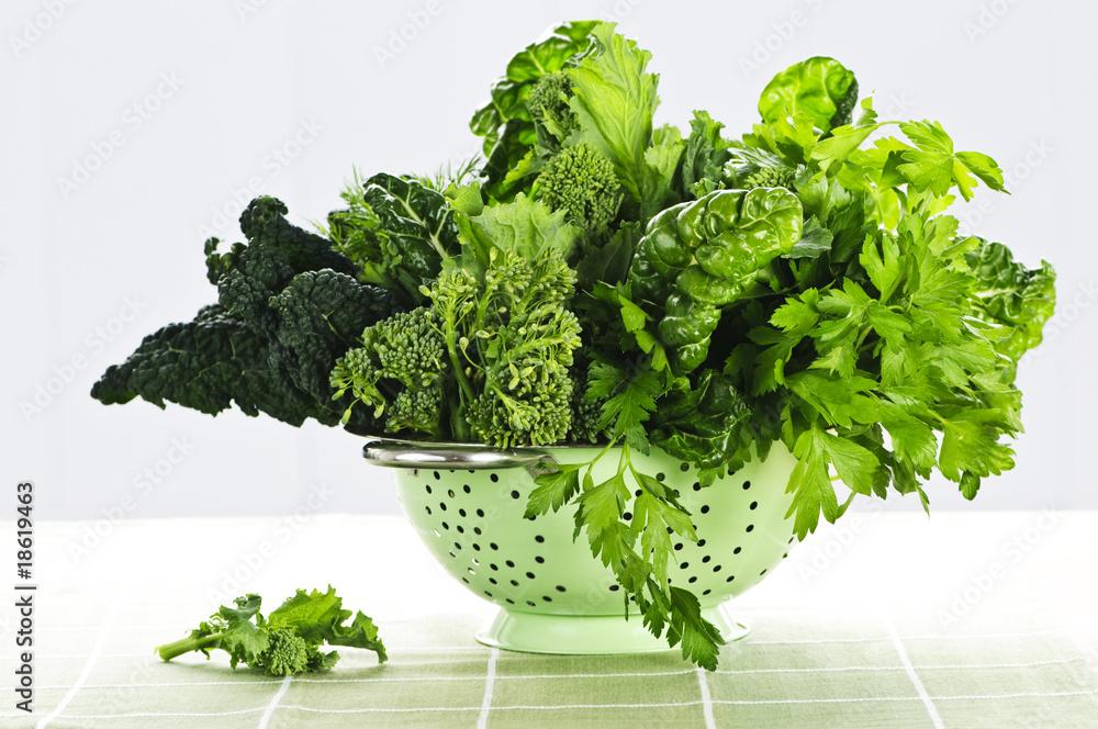 Dark green leafy vegetables in colander