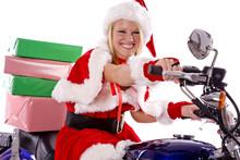 Santas Helper Delivering Gifts On Motorcycle