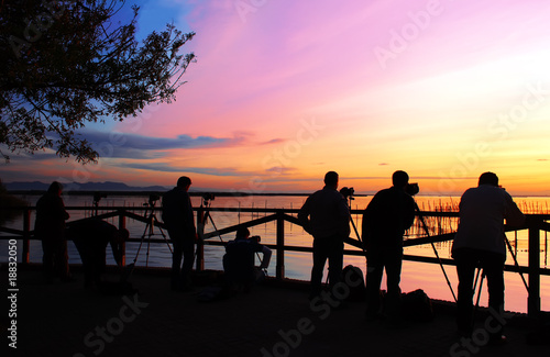 Fotobehang Pier fotografos en el atardecer