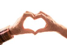 Senior Couple Forming Heart With Hands